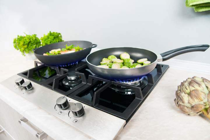 Cooking fish dish on stove