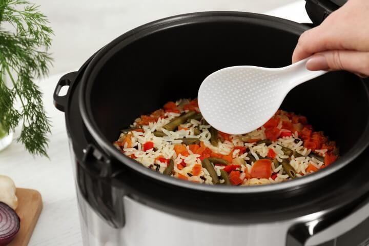 cooked rice with vegetables on rice cooker